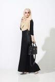 Asian malay woman posing with muslim attire Royalty Free Stock Image
