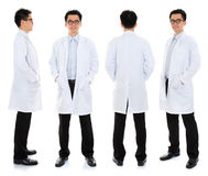 Asian male beauty therapist in beautician uniform. Full body Asian male beauty therapist in beautician uniform with confident smile, standing in different angle Stock Image
