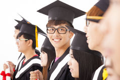 Asian male college graduate at graduation. With classmates Stock Photography