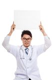 Asian male doctor with blank sign over head Stock Photos
