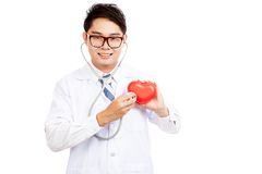 Asian male doctor check red heart with stethoscope Stock Images