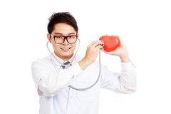 Asian male doctor check red heart with stethoscope Royalty Free Stock Photography