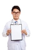 Asian male doctor with clipboard Stock Images