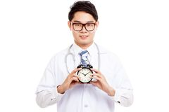 Asian male doctor with a clock Stock Photos