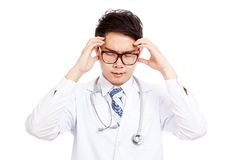 Asian male doctor got headache Stock Image