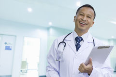 Asian male doctor with a happy smile Stock Images