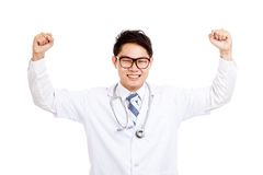 Asian male doctor  happy with success hold both fists up Royalty Free Stock Photo