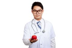 Asian male doctor with red apple Stock Photography