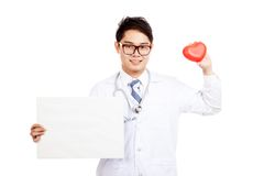 Asian male doctor with red heart and blank sign Stock Photography