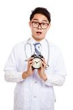 Asian male doctor shock show a clock Royalty Free Stock Images