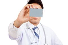 Asian male doctor show a card Stock Photo