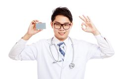 Asian male doctor show a card and OK sign Stock Photography