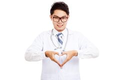 Asian male doctor show heart hand sign Stock Photos
