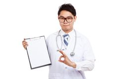 Asian male doctor show OK sign with clipboard Stock Photos