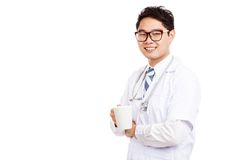 Asian male doctor smile with a coffee mug Stock Photography
