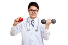 Asian male doctor smile with red apple and dumbbell Stock Image