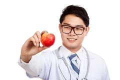 Asian male doctor smile show red apple Royalty Free Stock Photography