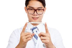 Asian male doctor smile show  thermometer. Isolated on white background Royalty Free Stock Images