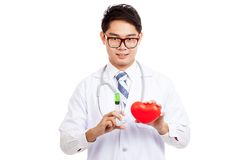 Asian male doctor with syringe and red heart Royalty Free Stock Images