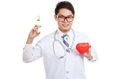 Asian male doctor with syringe and red heart Royalty Free Stock Photos