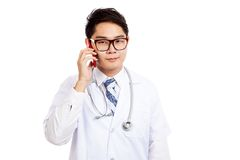 Asian male doctor talk on mobile phone Royalty Free Stock Image