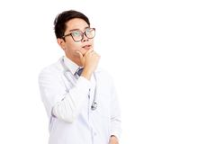 Asian male doctor think and look up Stock Image