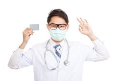 Asian male doctor wear mask show OK with blank card Stock Image