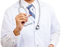 Asian male doctor write in the air with red marker Stock Photos