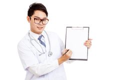 Asian male doctor write on blank paper on clipboard Royalty Free Stock Images