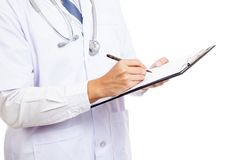 Asian male doctor write  on clipboard Royalty Free Stock Images