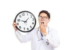 Asian male doctor yawn with a clock Royalty Free Stock Photos