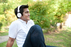 Asian Male enjoying music Royalty Free Stock Image