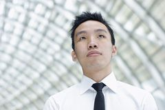 Asian male executive looking up Stock Photography