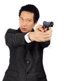 Asian male with a gun on white Stock Images