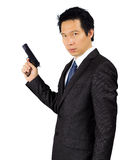Asian male with a gun on white Stock Photography
