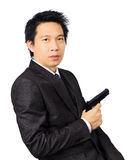 Asian male with a gun on white Stock Photos