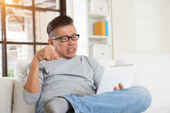 Asian male with hand pain Stock Photography