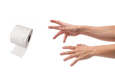 Asian male hands reaching out for toilet paper. Asian male hands reaching out for a roll of toilet paper on isolated white background Royalty Free Stock Photo