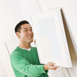 Asian male hanging art Stock Images
