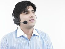 Asian male with his headphones Royalty Free Stock Images