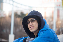 Asian male in hood wear  smile Royalty Free Stock Photos