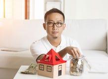 Asian male house loan Stock Photo