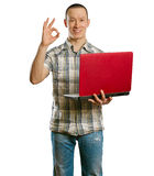 Asian male with laptop in his hands shows OK Stock Photos