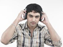 Asian male listening to music Royalty Free Stock Images