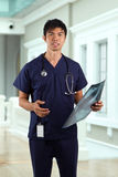 Asian Male nurse holding an X-ray Royalty Free Stock Image