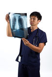 Asian Male nurse looking at an X-ray Royalty Free Stock Image