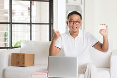 Asian male online shopping alone Royalty Free Stock Images