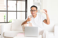 Asian male online shopping alone Stock Photo