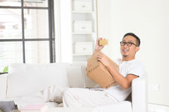 Asian male online shopping Stock Photos