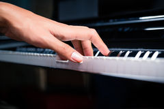 Asian male pianist playing piano in recording studio Royalty Free Stock Image